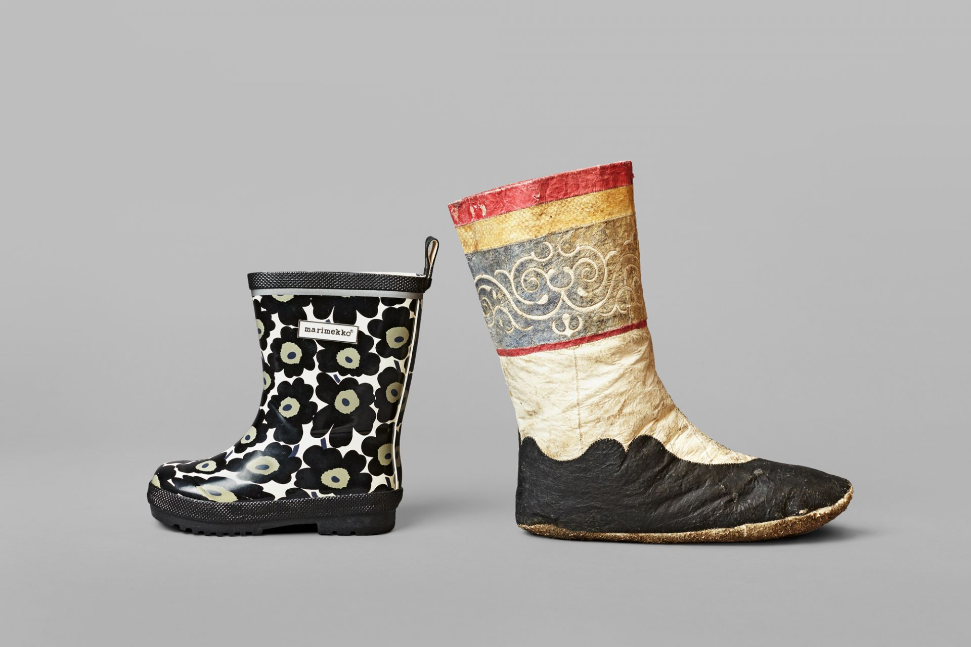Children boot with salmon leather, Siberia, early 20th century and children's rubber boot, Unikko-Saapas, marimekko, Helsinki, Finland, 2005/06